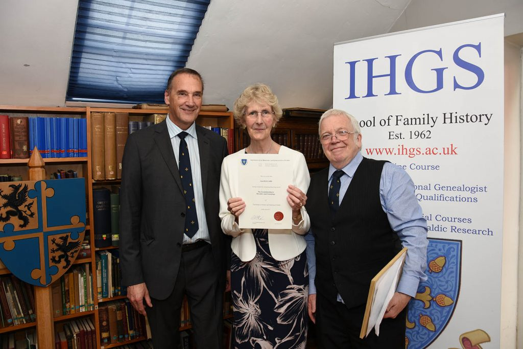 Ann Ballard receiving the Licentiateship of The Institute of Heraldic and Genealogical Studies, presented by Lord Lytton and IHGS principal Dr Richard Baker.